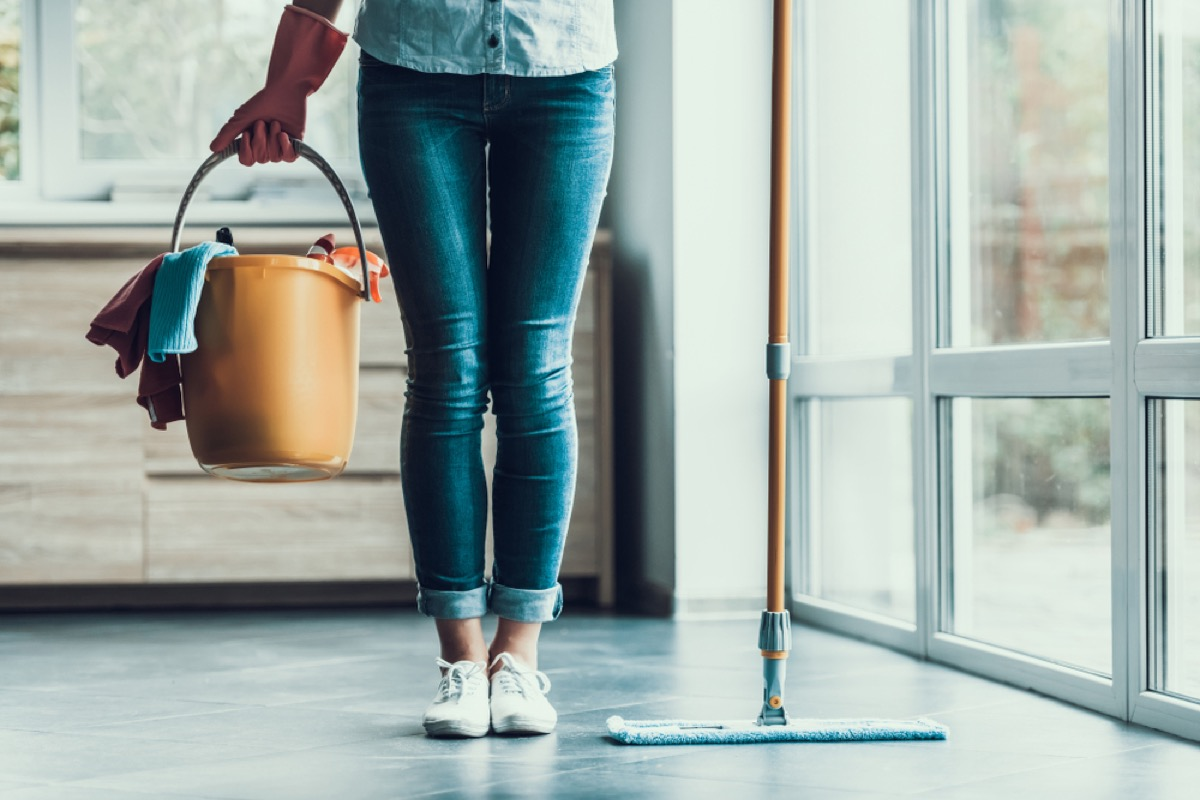 woman holding cleaning bucket, essential home supplies