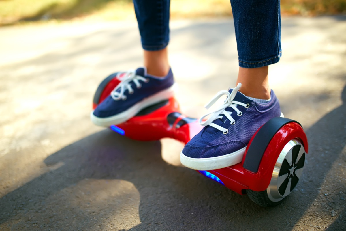 woman riding hoverboard in canvas sneakers, fire prevention tips