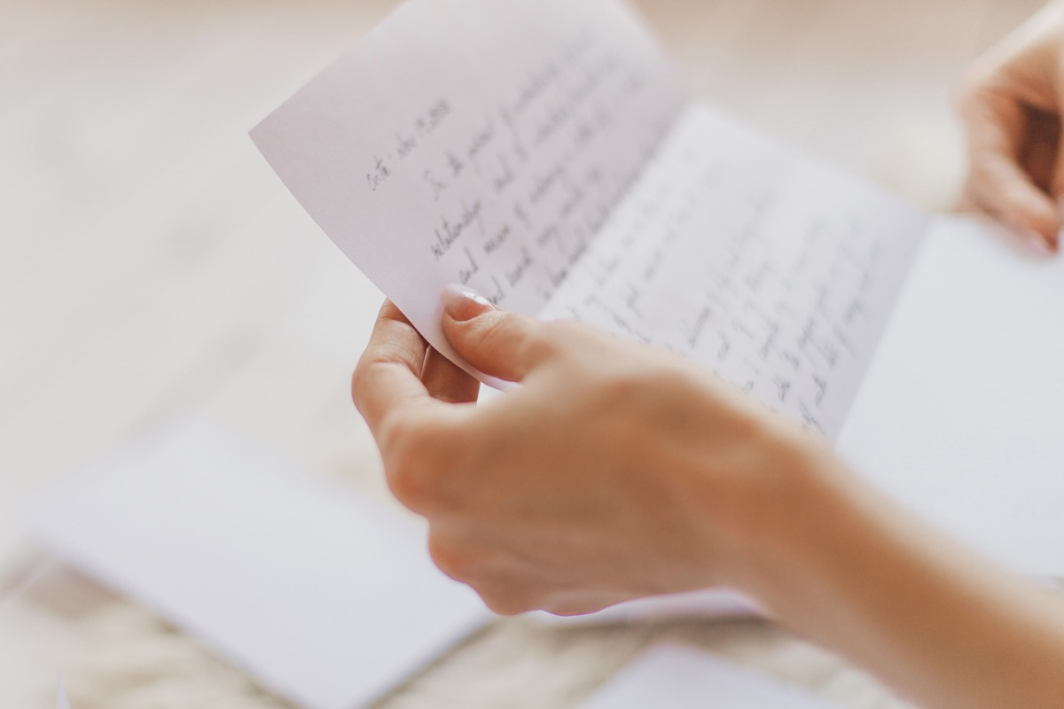 woman reading old love letters