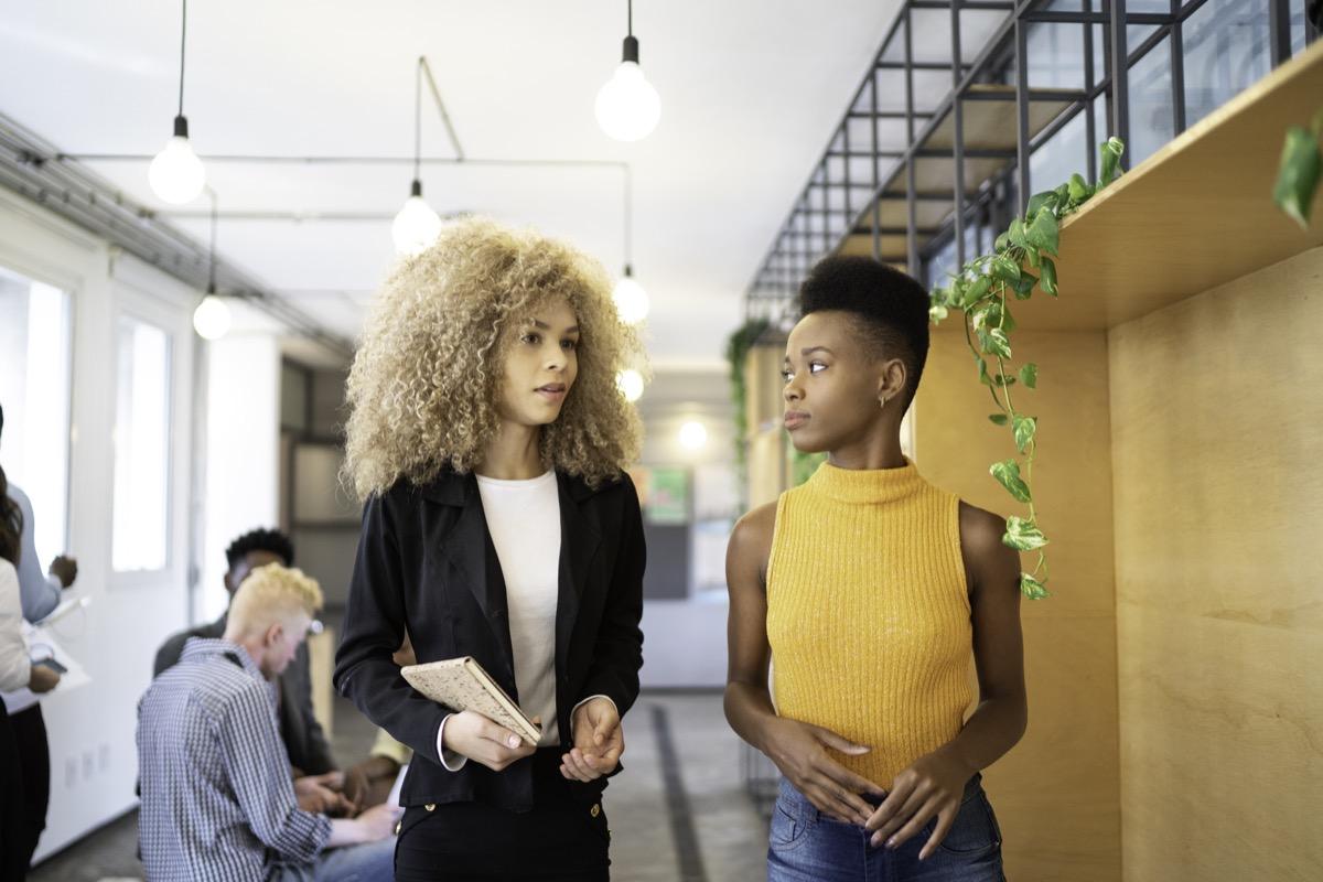 Two businesswoman walking at modern office