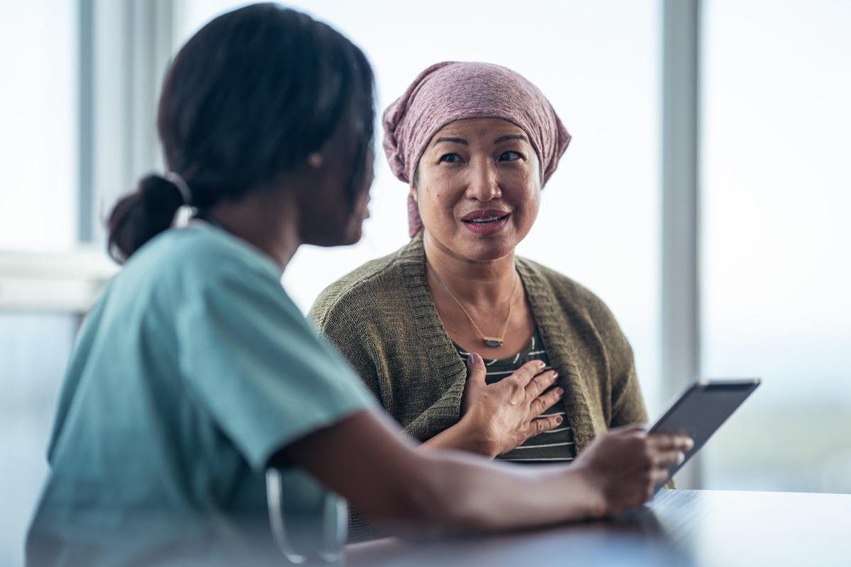 an older woman talking to her doctor while in the office