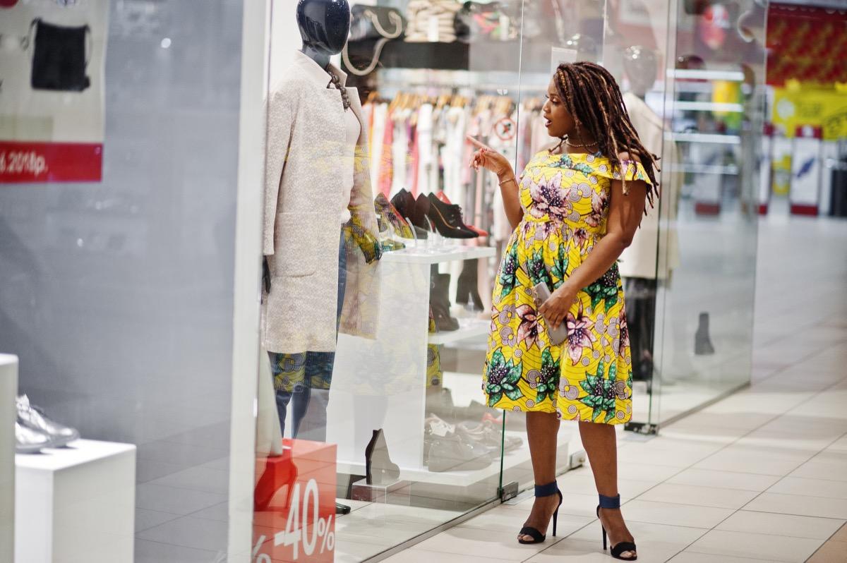 woman window shopping at mall