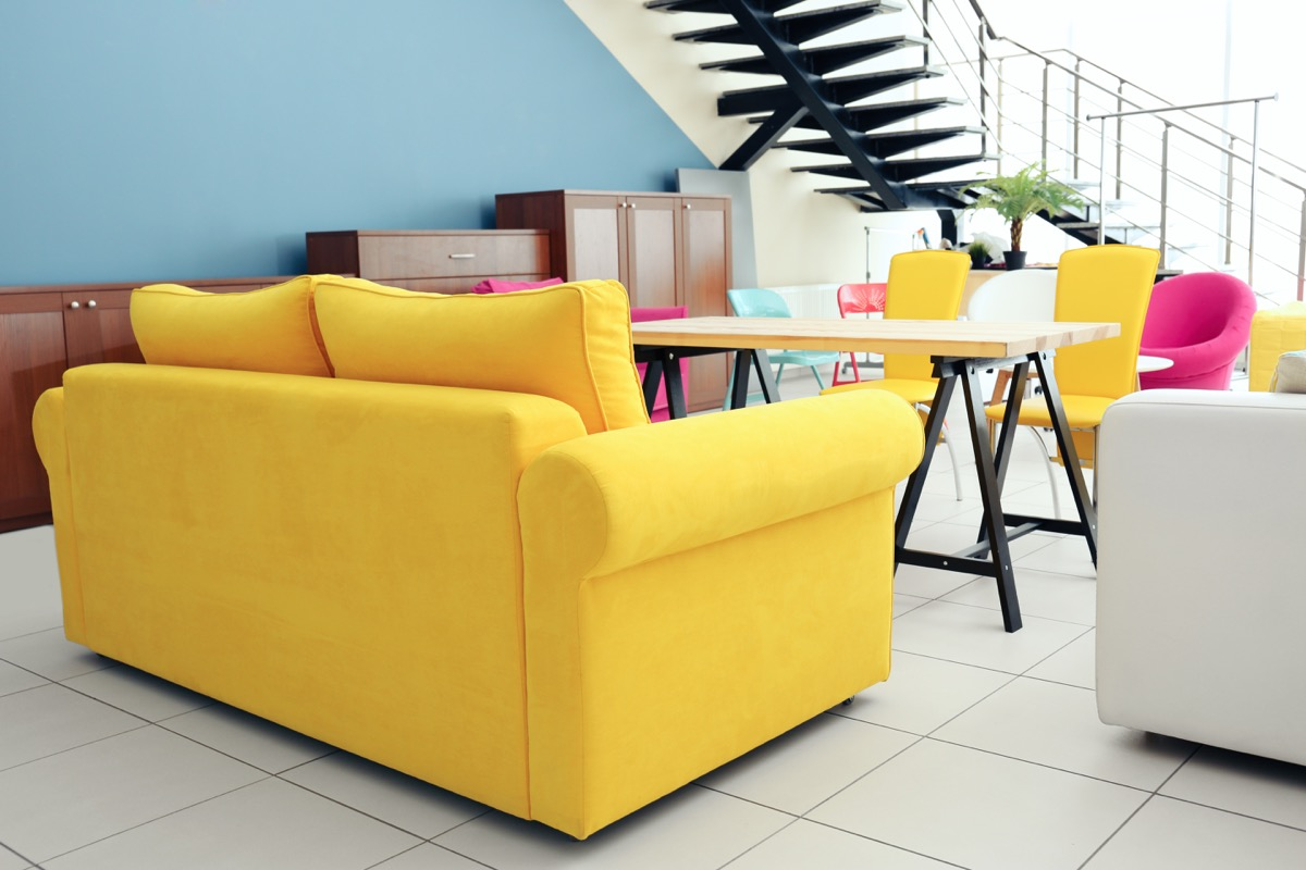 A bright yellow couch vintage home trends