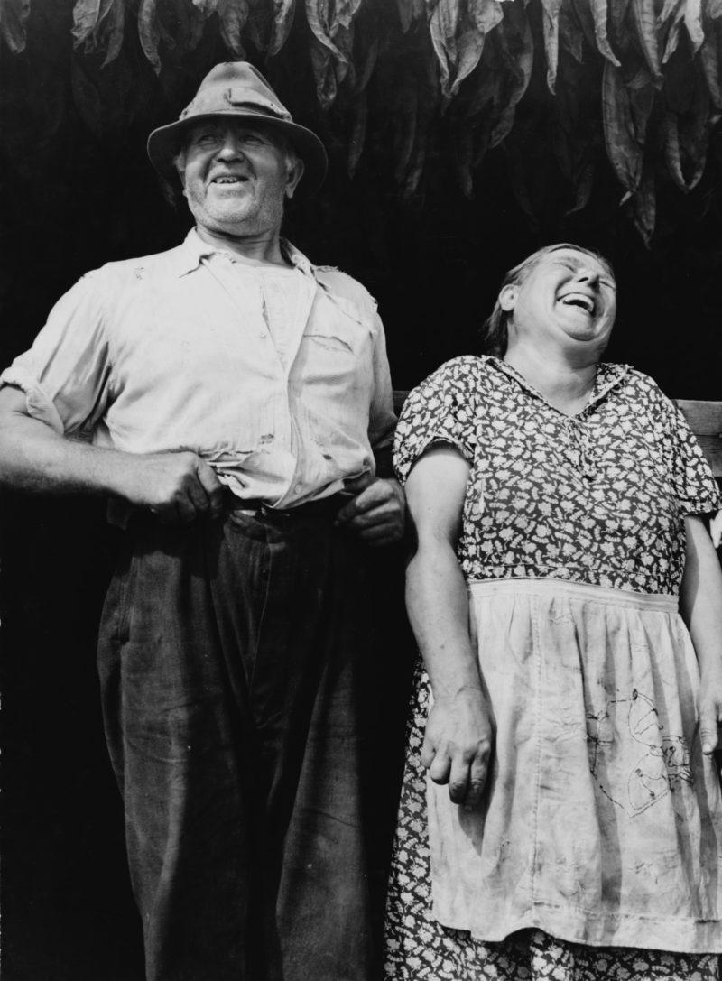 1940s Polish tabacco farmer couple laughing