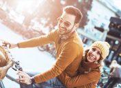 Man and woman riding a bike