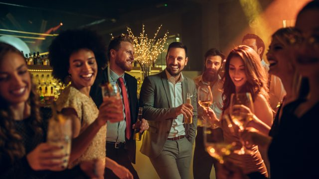 Group of young professionals at offline dating mixer
