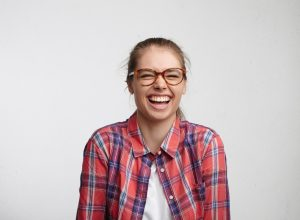Woman in glasses laughing