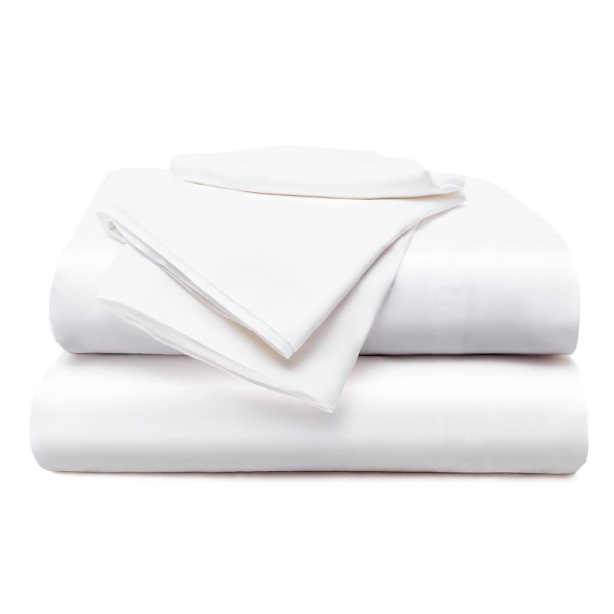 set of white folded sheets on white background