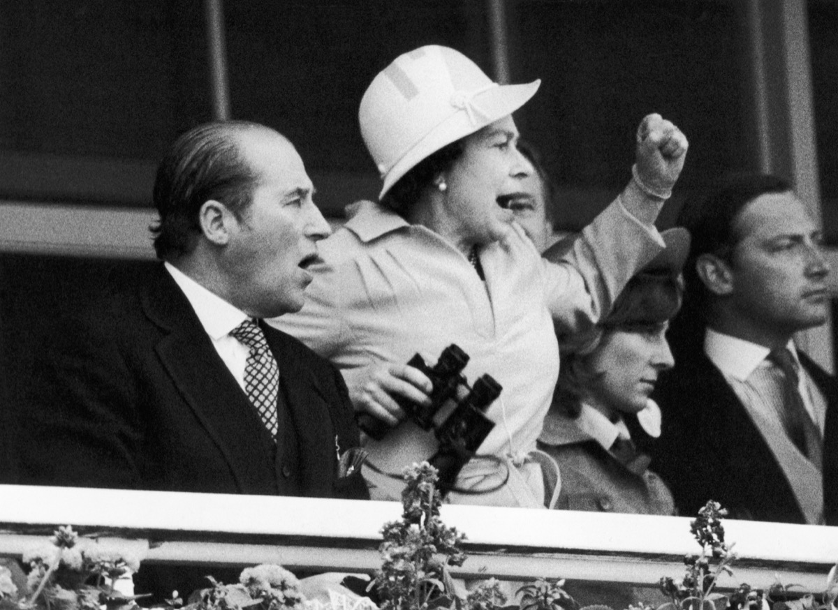 The Queen and her racing manager Lord Porchester watch the finish of the 1978 Epsom Derby . 8th June 1978