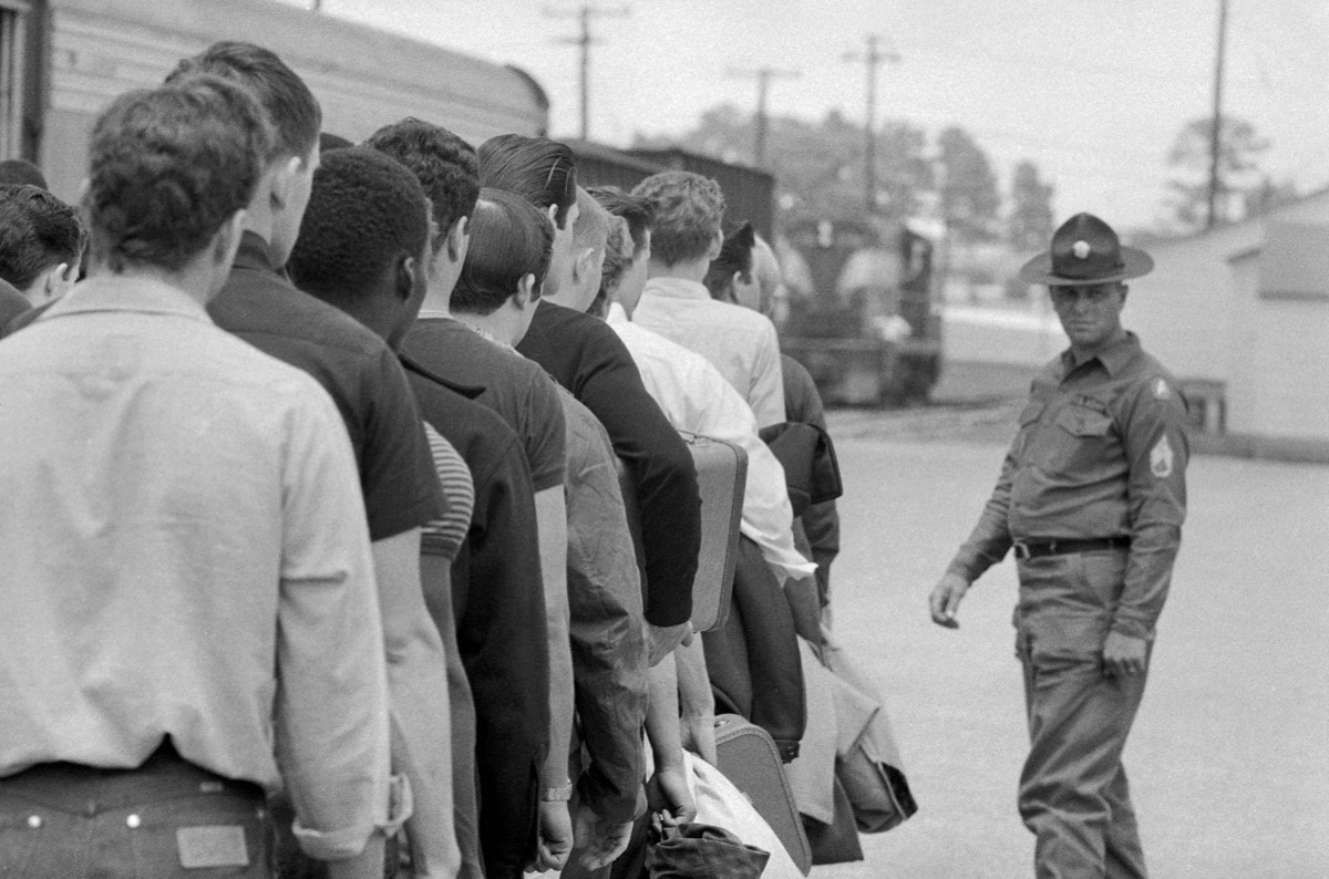 Vietnam Draft. Young men who have been drafted wait in line to be processed into the U.S. Army at Fort Jackson, Columbia, South Carolina, May 1967.