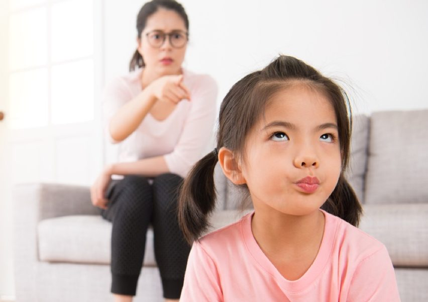 asian girl annoyed at scolding mom