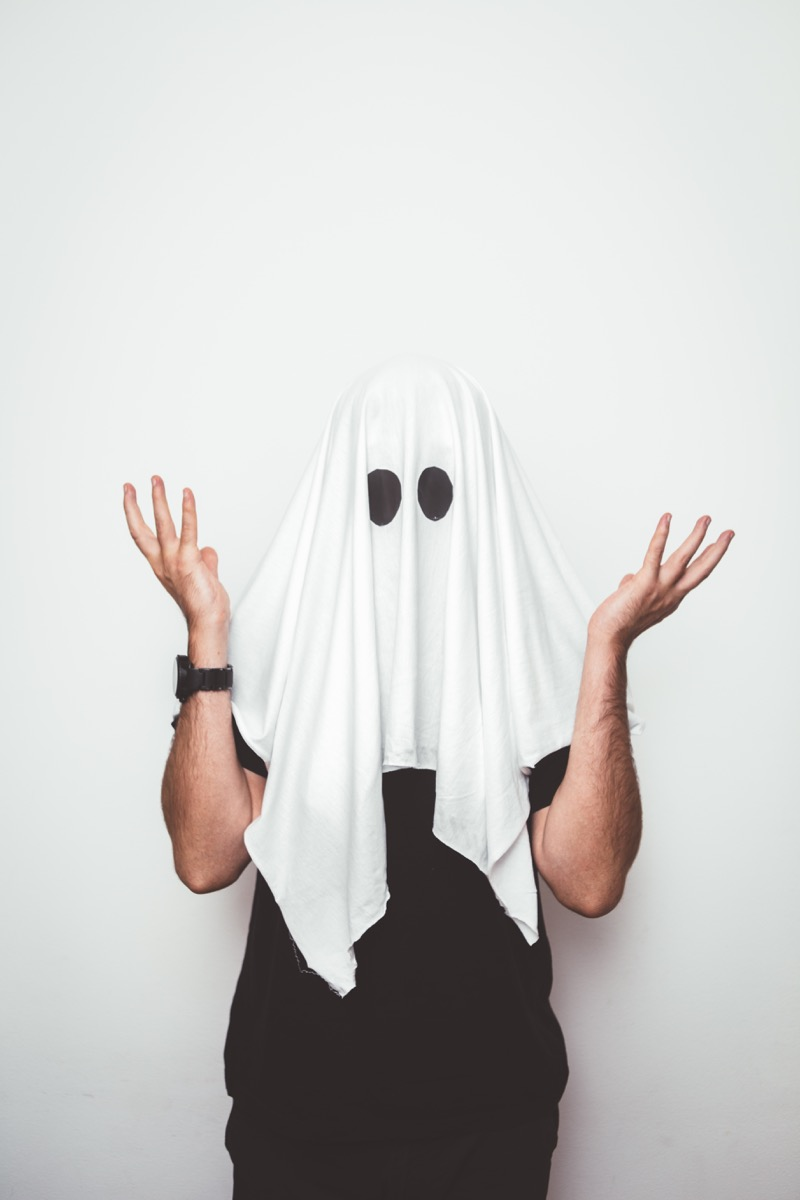 Bad Halloween costume of a ghost made out of a sheet