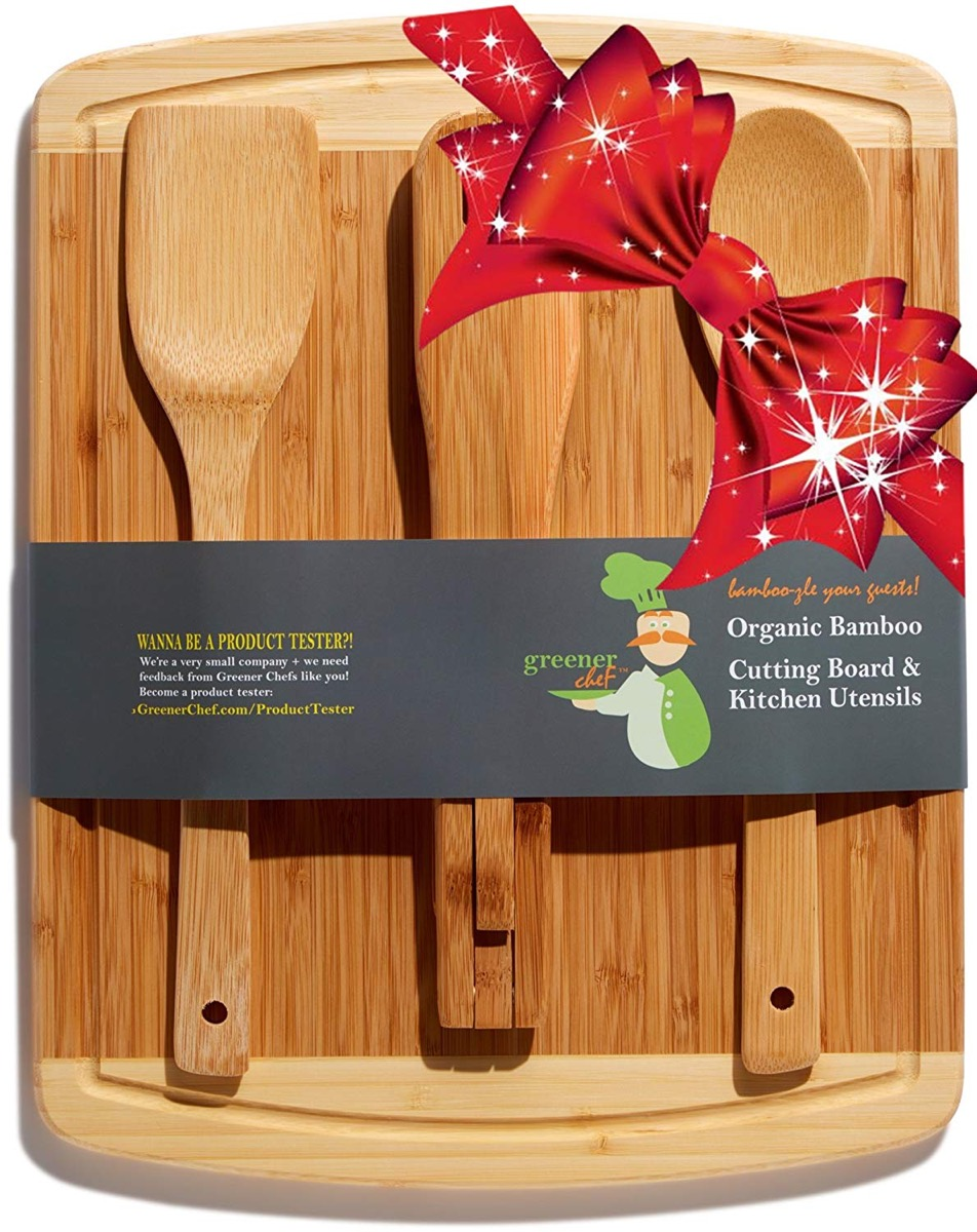 wooden cutting board with three spatulas on it