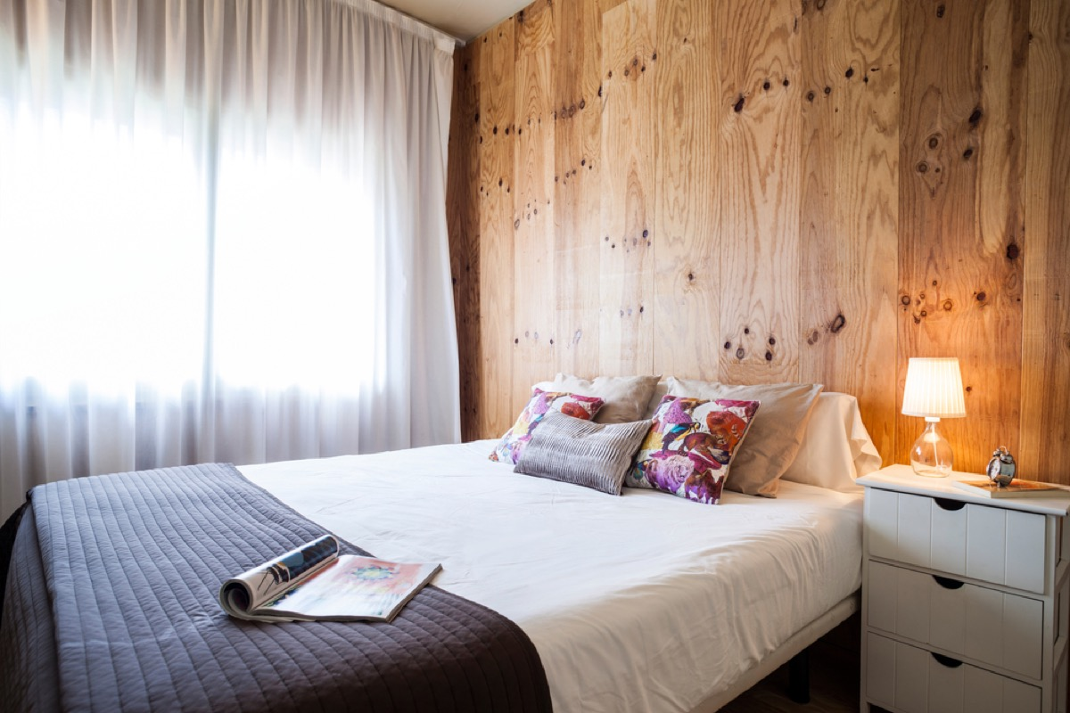 wood walls behind bed