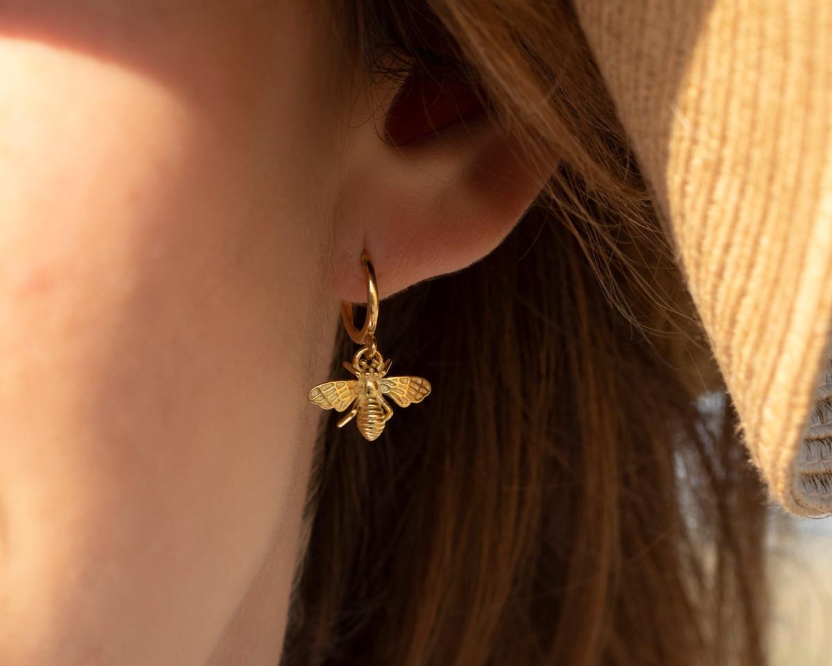 woman wearing gold bee earrings, Etsy jewelry