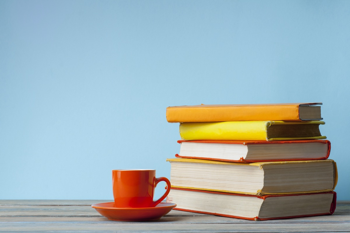 stack of books next to teacup