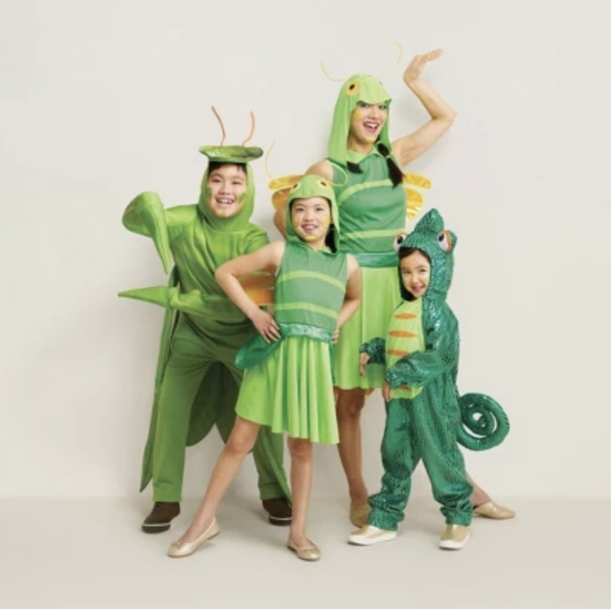 family dressed as green bugs, family halloween costumes