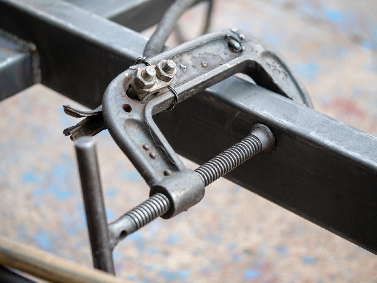 c clamp holding together metal track