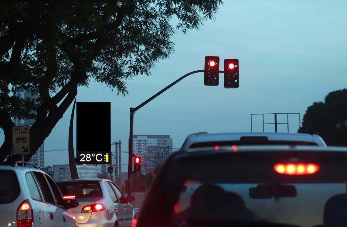 Scenes of traffic jam in the evening in a big city such as S√£o Paulo, with red lights.