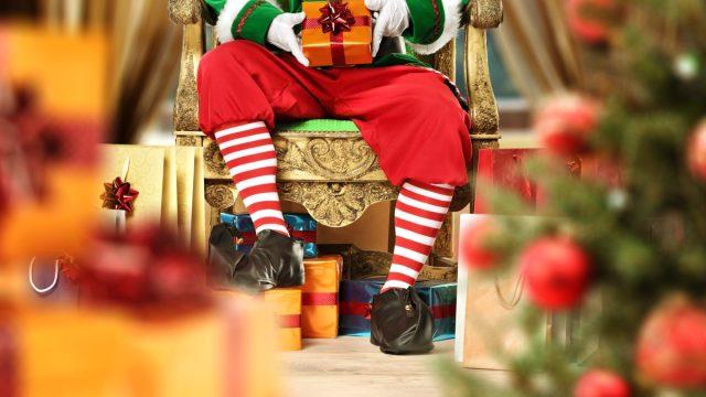 christmas elf holding present