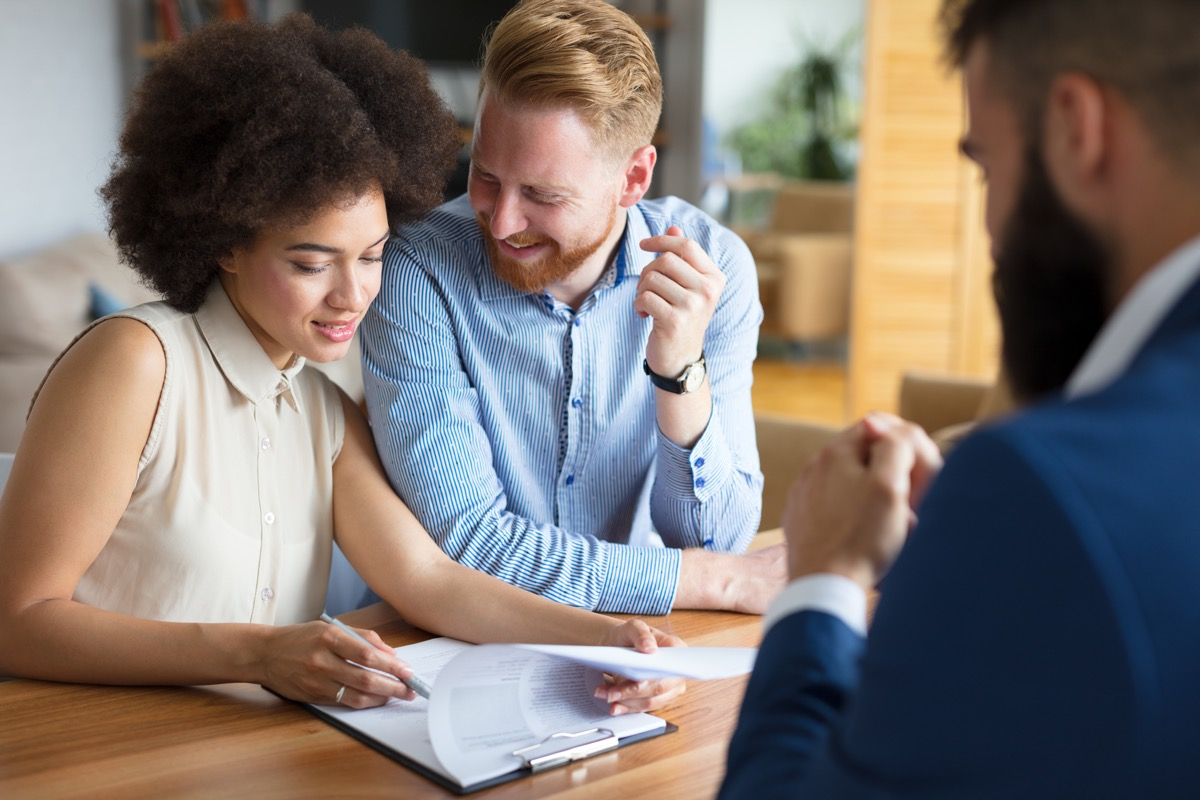 couple talking to a financial advisor about paying off their