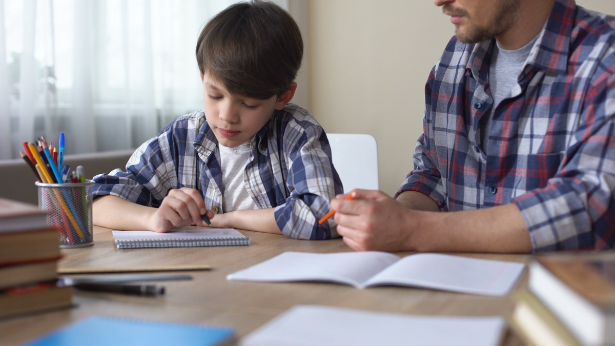 dad helping child with homework