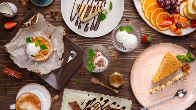 a table full of various desserts