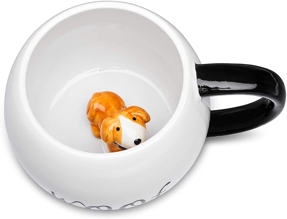 A cute dog mug from Amazon with a fun creature inside