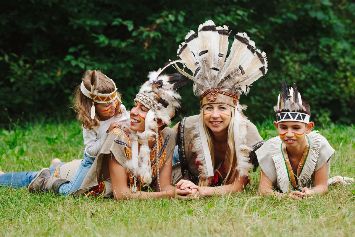 A family dressed inappropriately as Native Americans