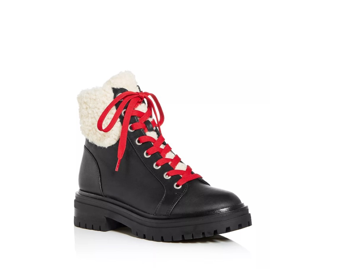 black combat boots with shearling cuff and red laces