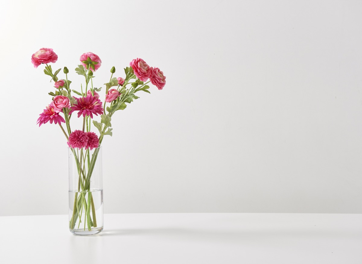 flower vase on a plain white table, getting rid of junk