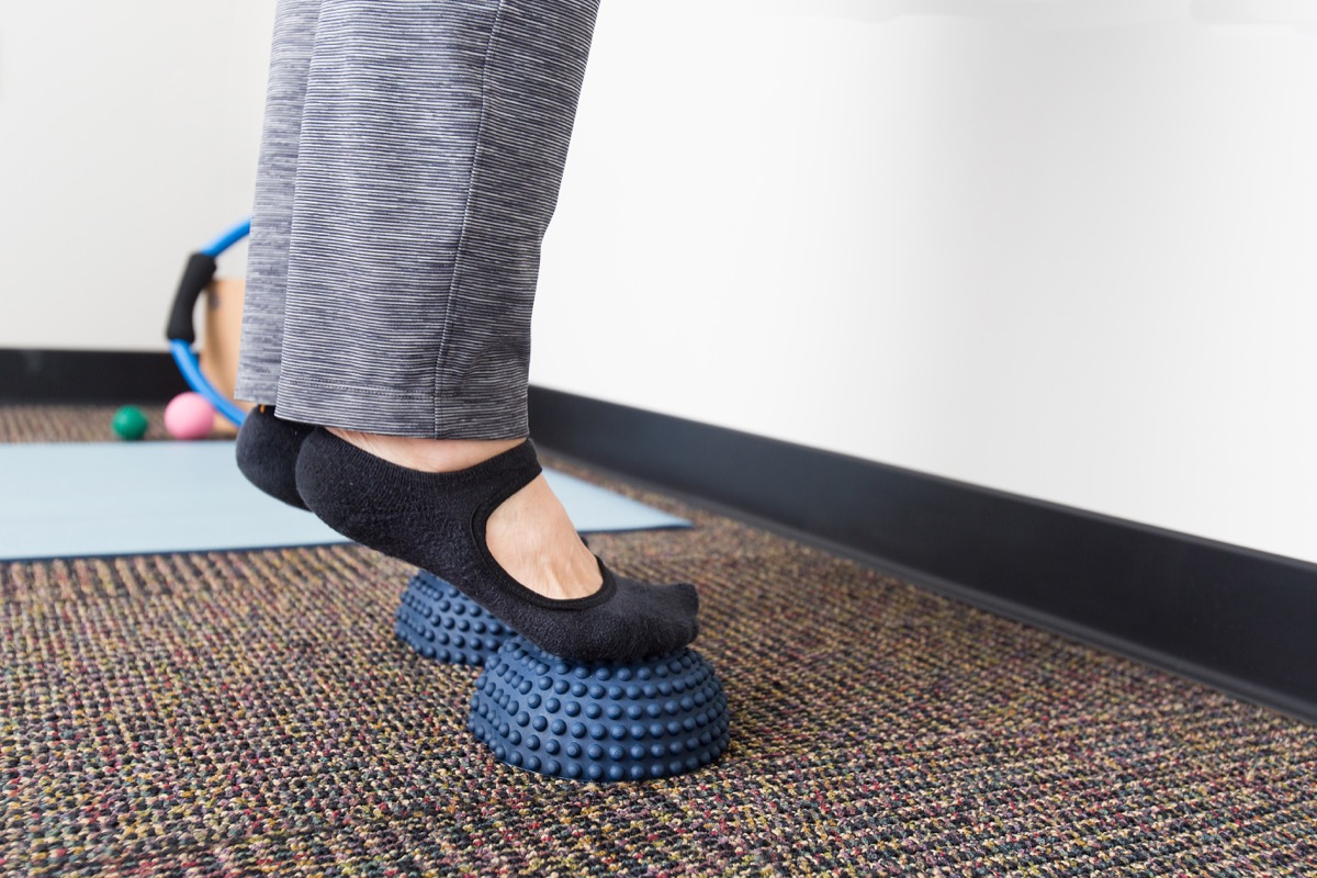 Woman doing foot stretch exercises