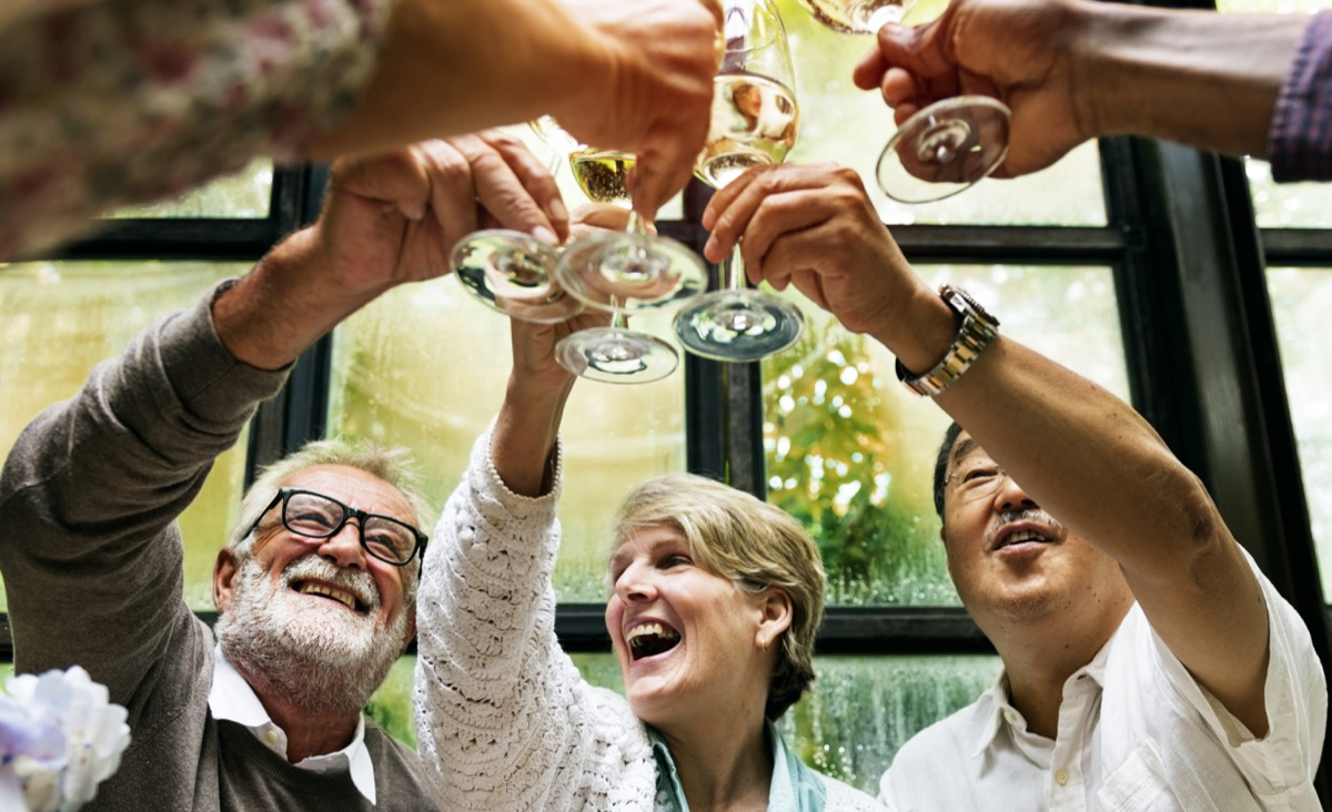 group of older adults drinking a champagne toast