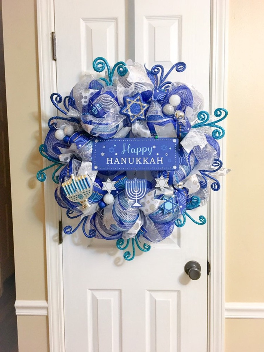 blue hanukkah wreath on white door, hanukkah decorations