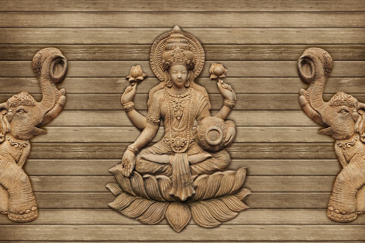 wooden figure of the hindu goddess lakshmi
