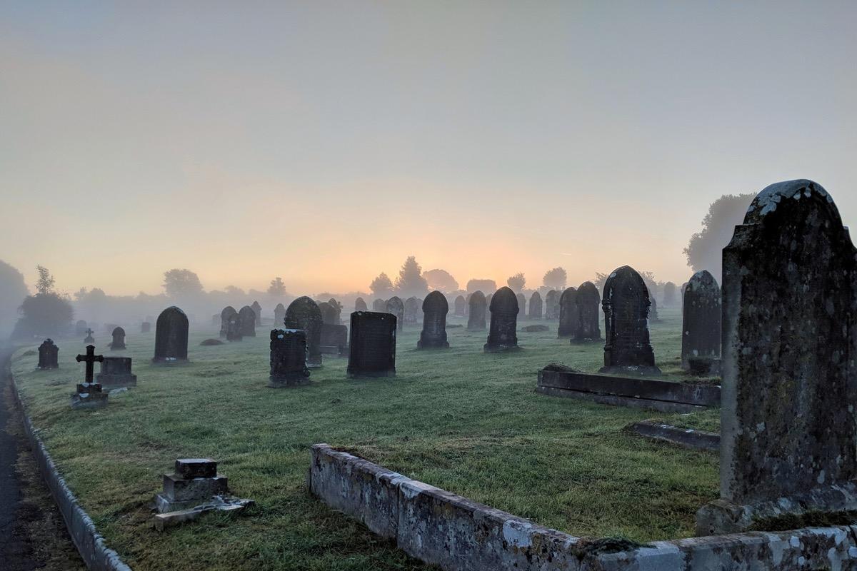 Misty cemetery at sunrise