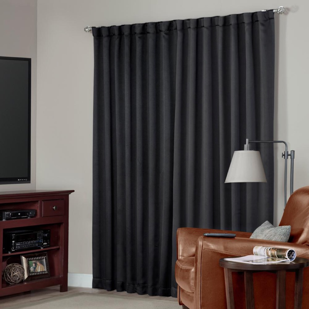 gray room with dark gray blackout curtains, better sleep essentials
