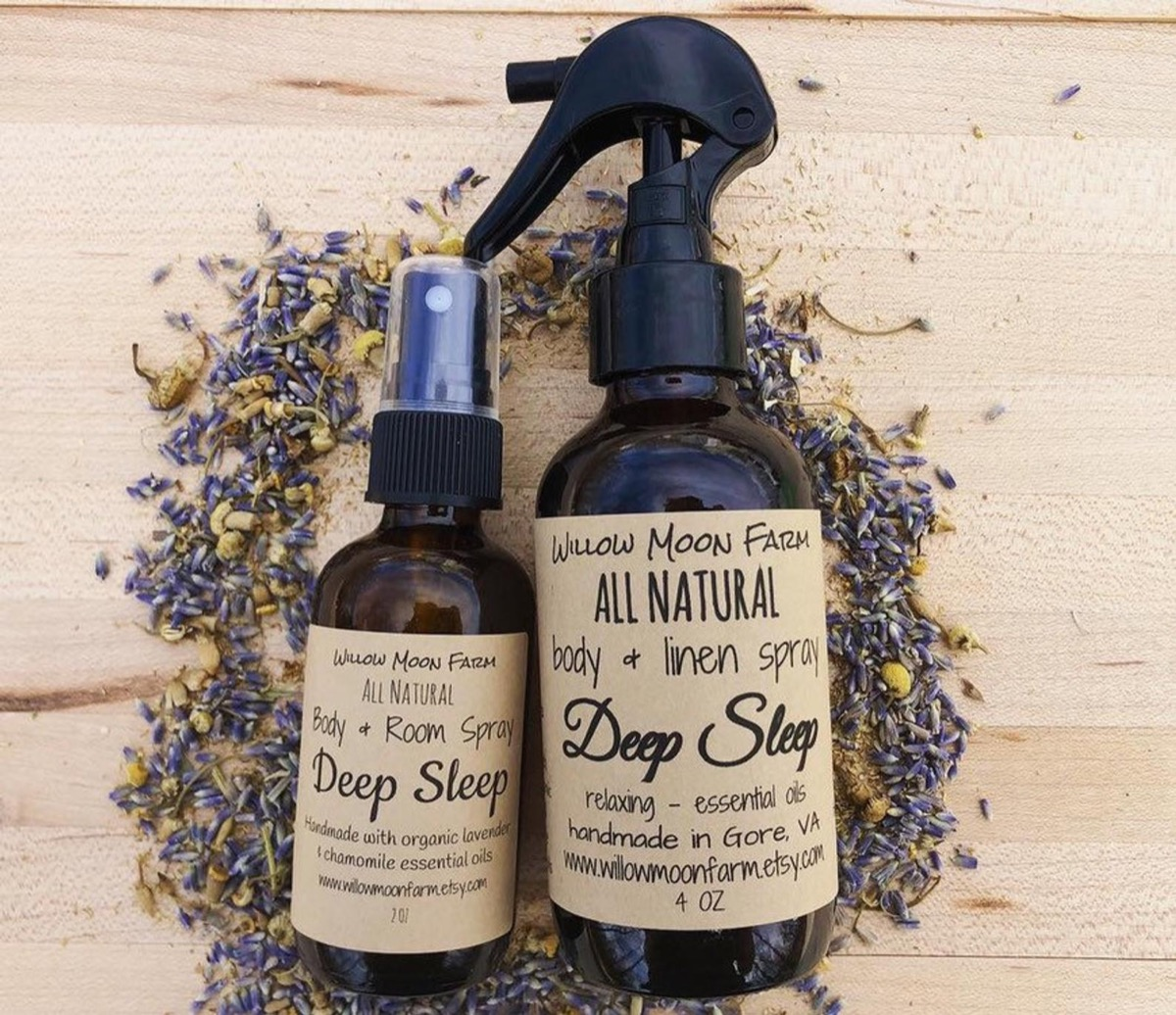 two brown bottles with brown labels on a bed of crushed lavender, better sleep essentials