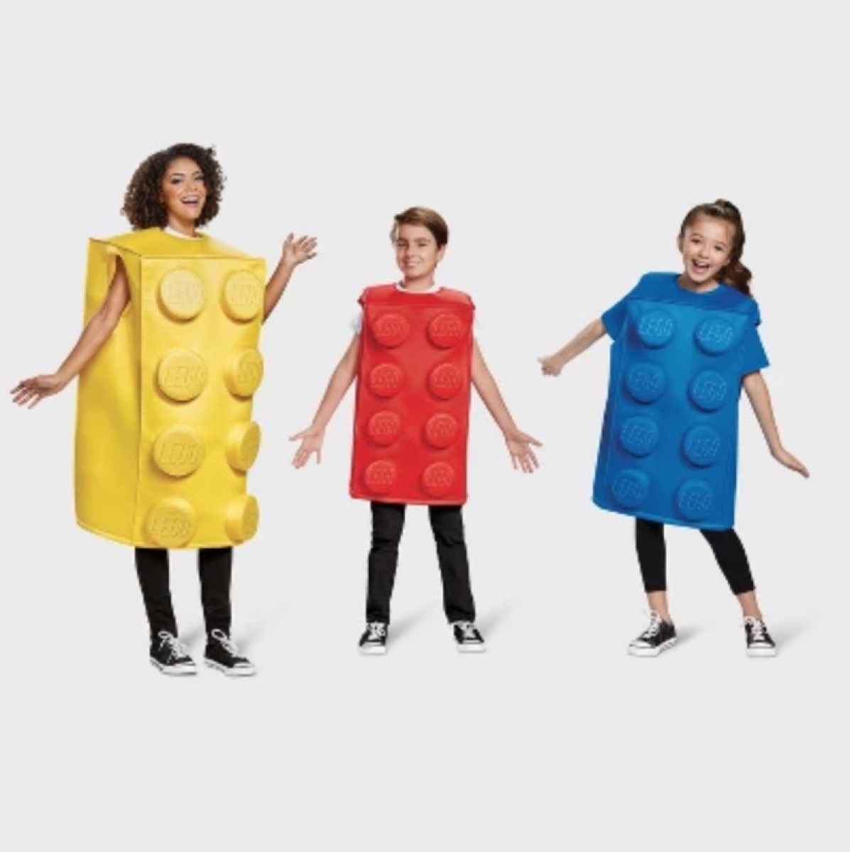 woman and two children in yellow, red, and blue lego brick costumes, family halloween costumes