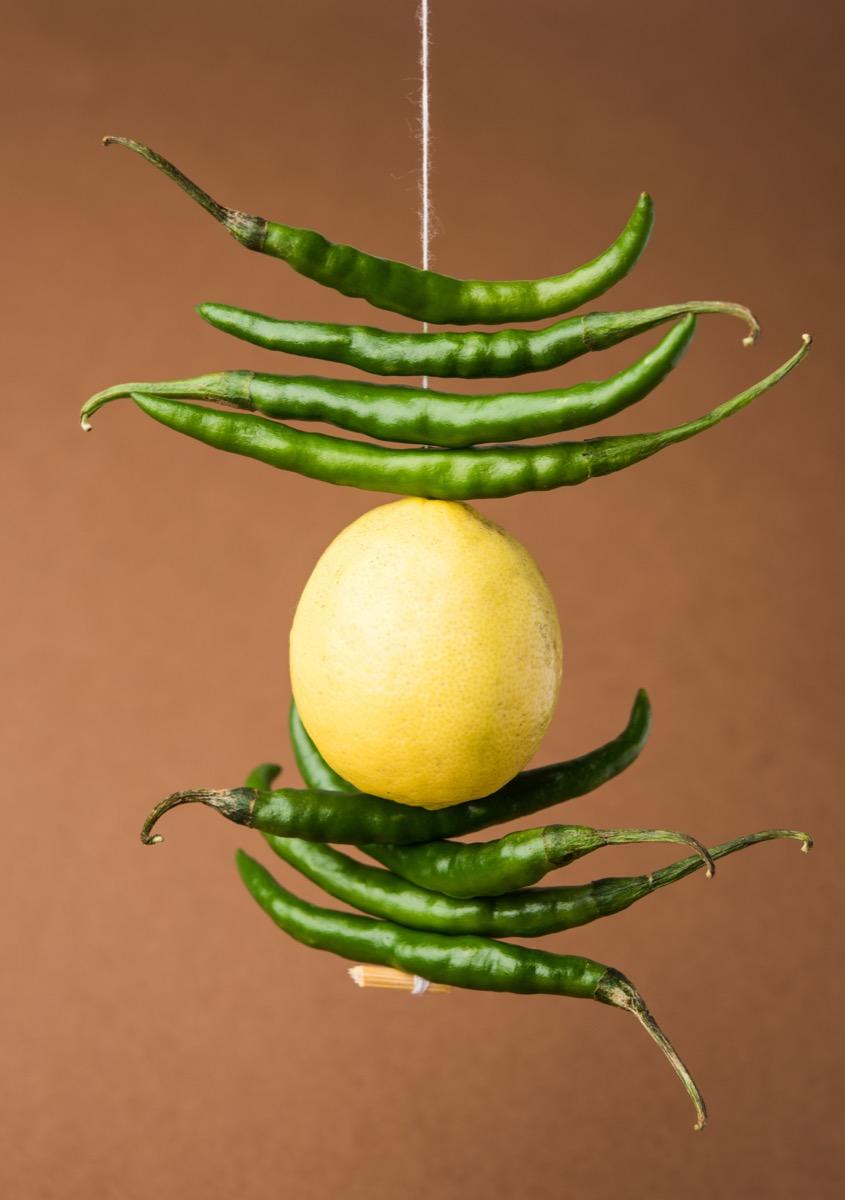 lemon and chili hung on a string