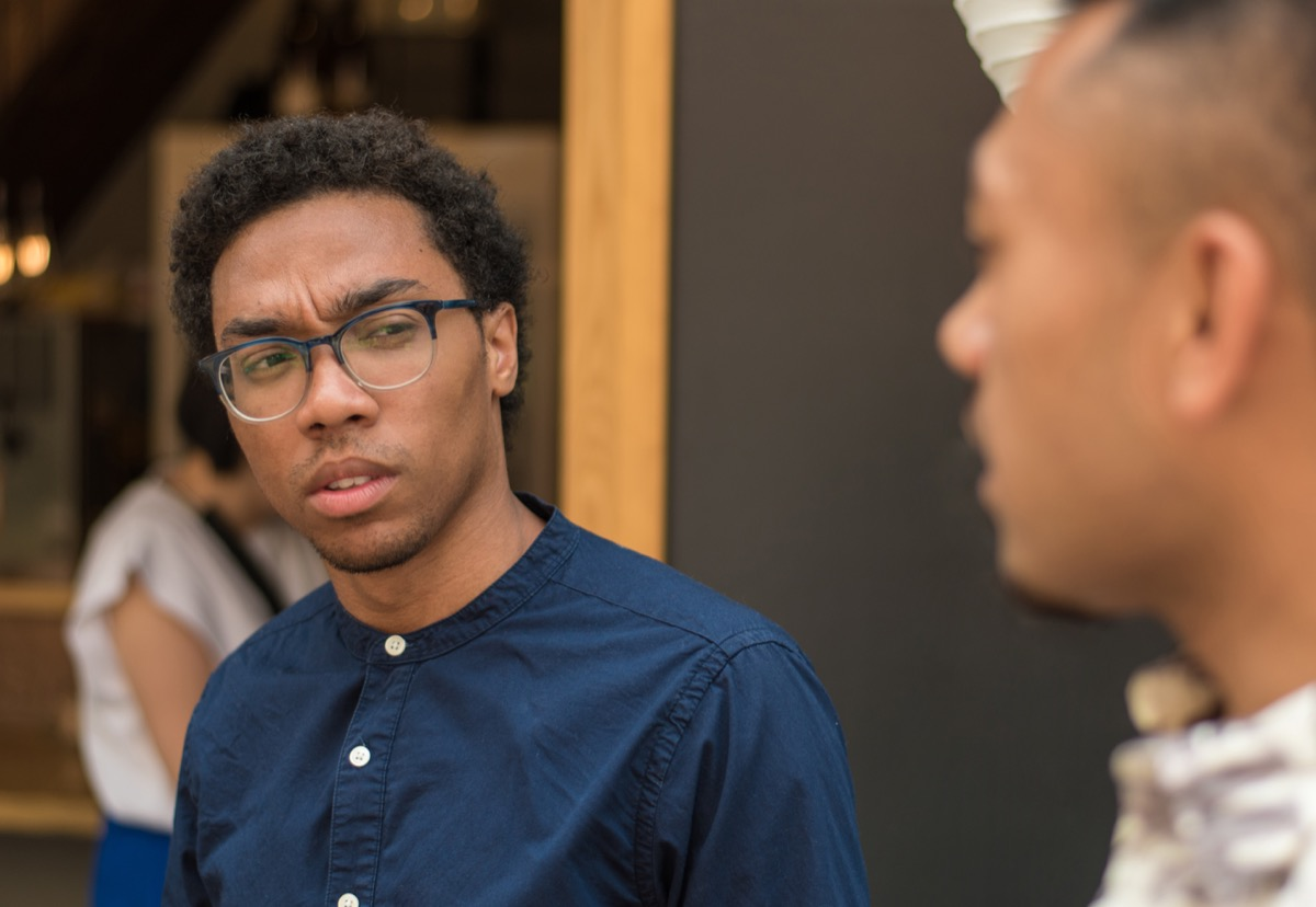 Man looking annoyed during a conversation how to have a conversation