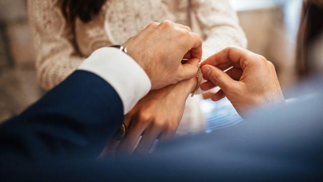 man clasping bracelet on woman's wrist, etsy jewelry