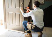 man installing front door lock