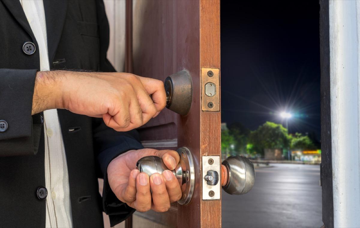 man locking door from inside
