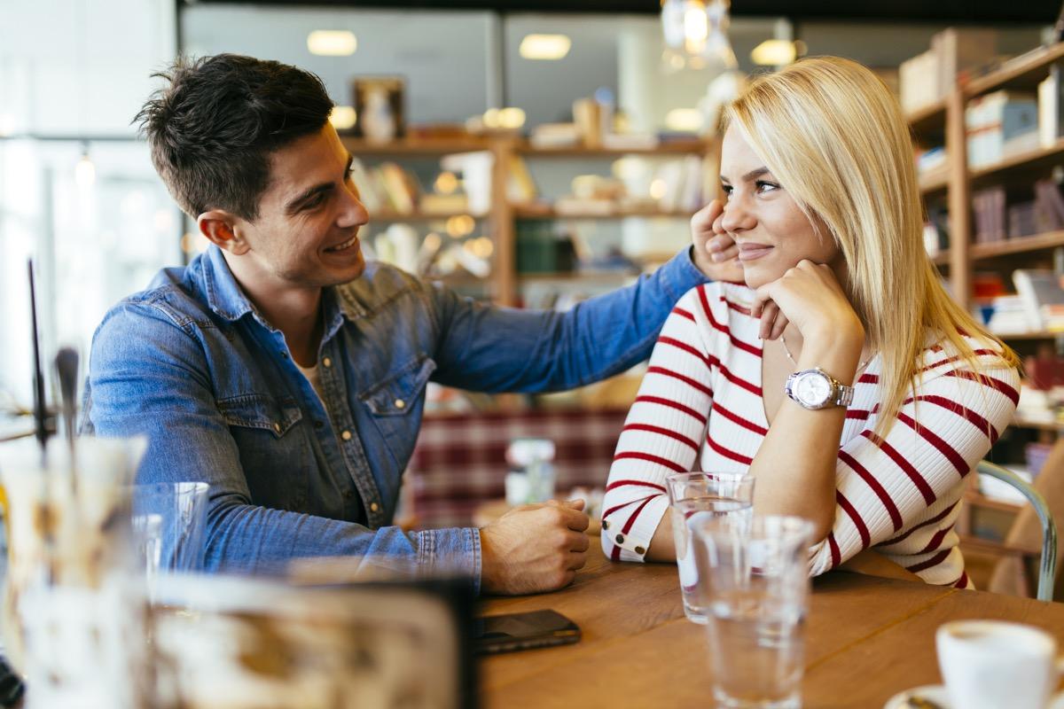 Beautiful couple in love flirting in restaurant and bonding