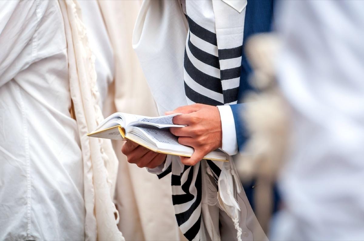man wearing tallit and reading torah, rosh hashanah facts