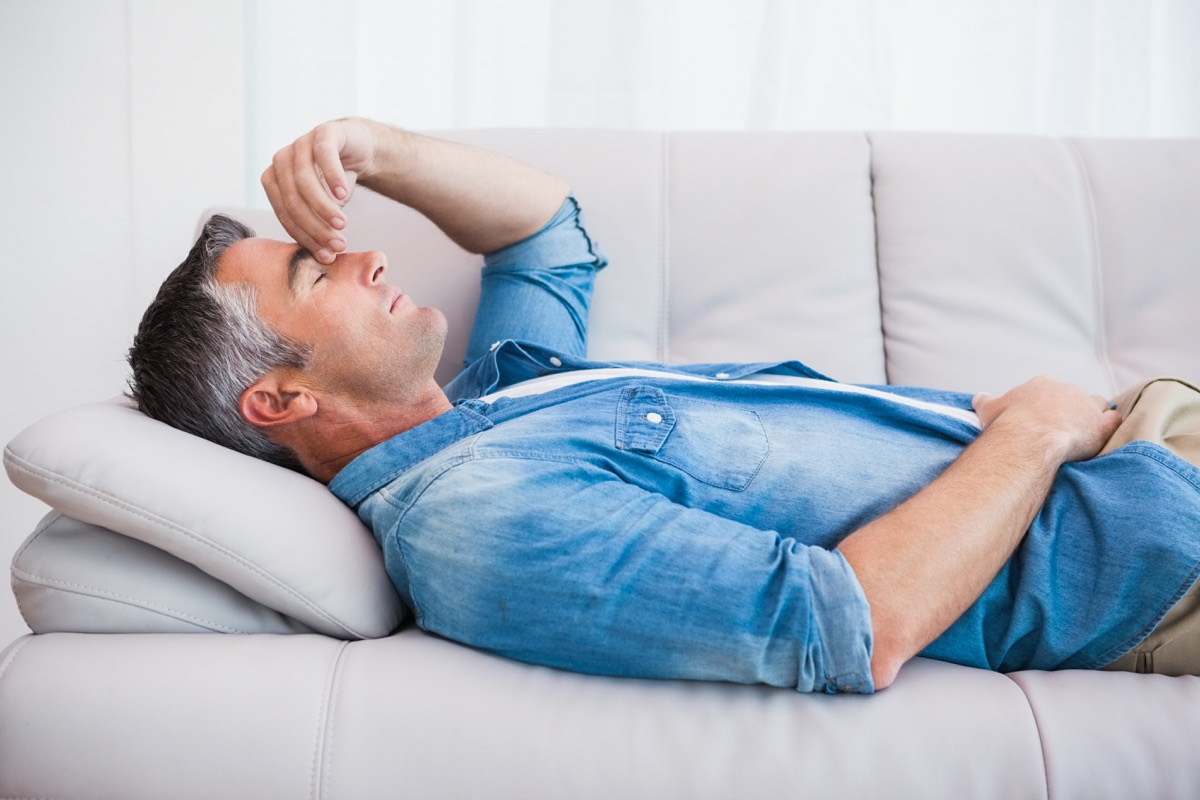 older man sleeping on couch