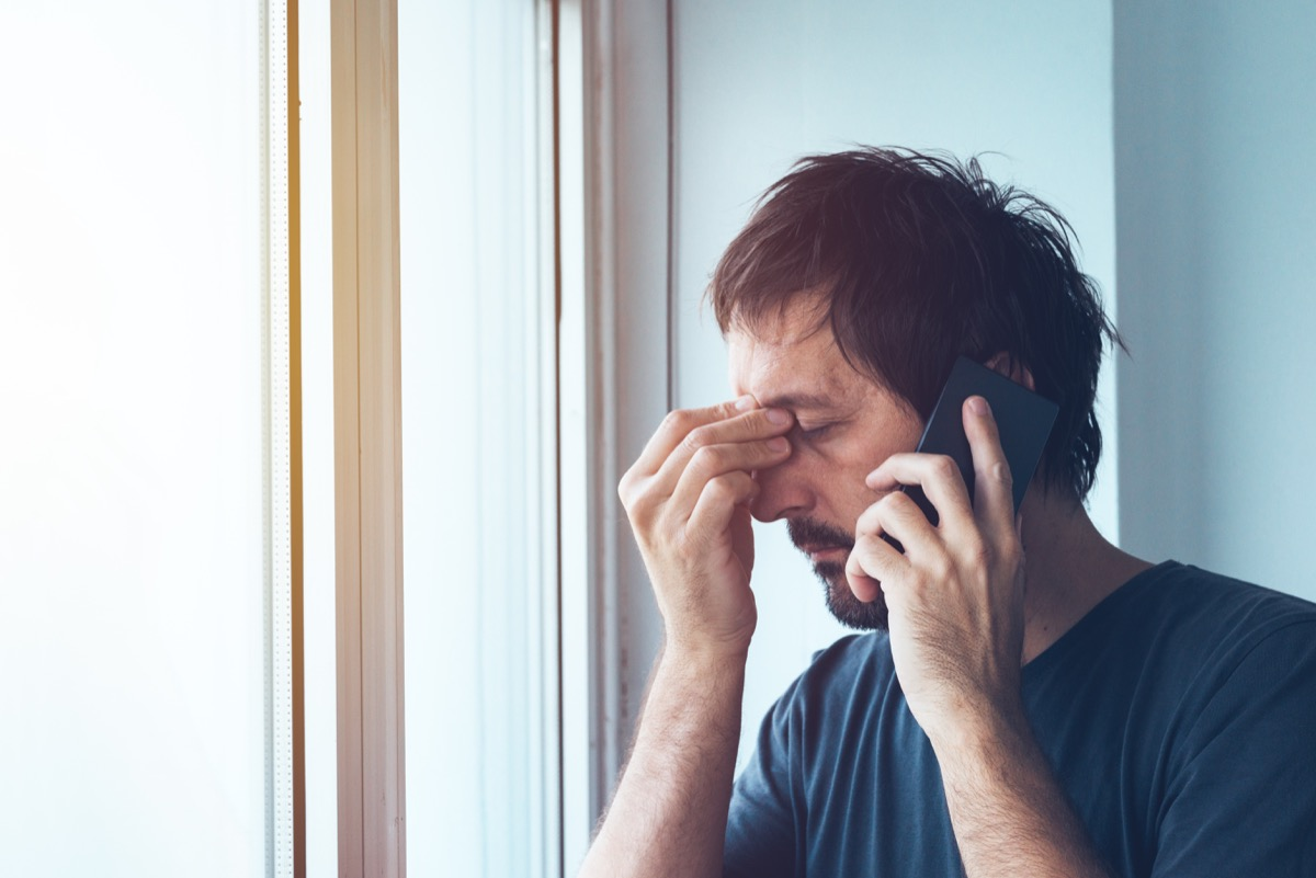 man upset with telemarketing robocalls while talking to a telemarketer on a cell phone