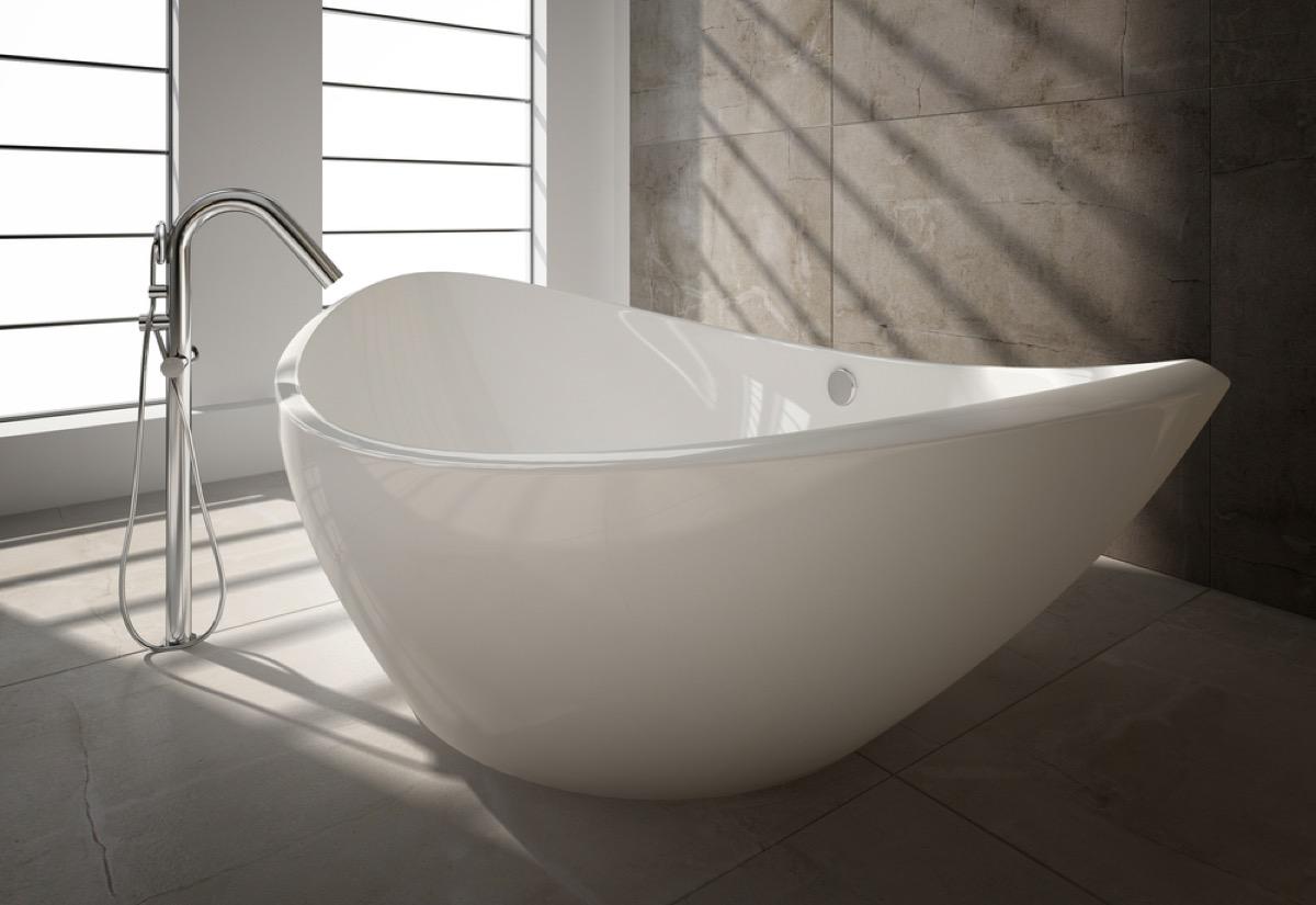 white freestanding tub next to silver faucet