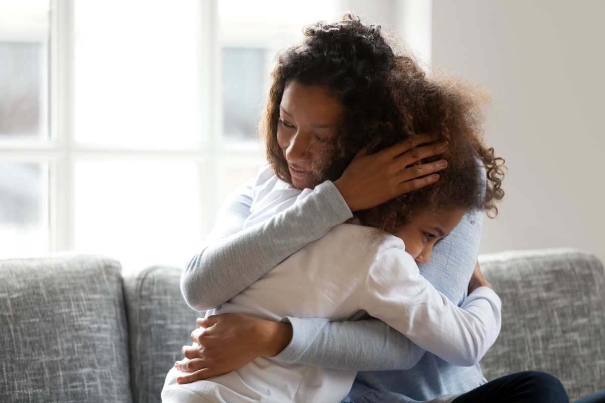 mom hugging child